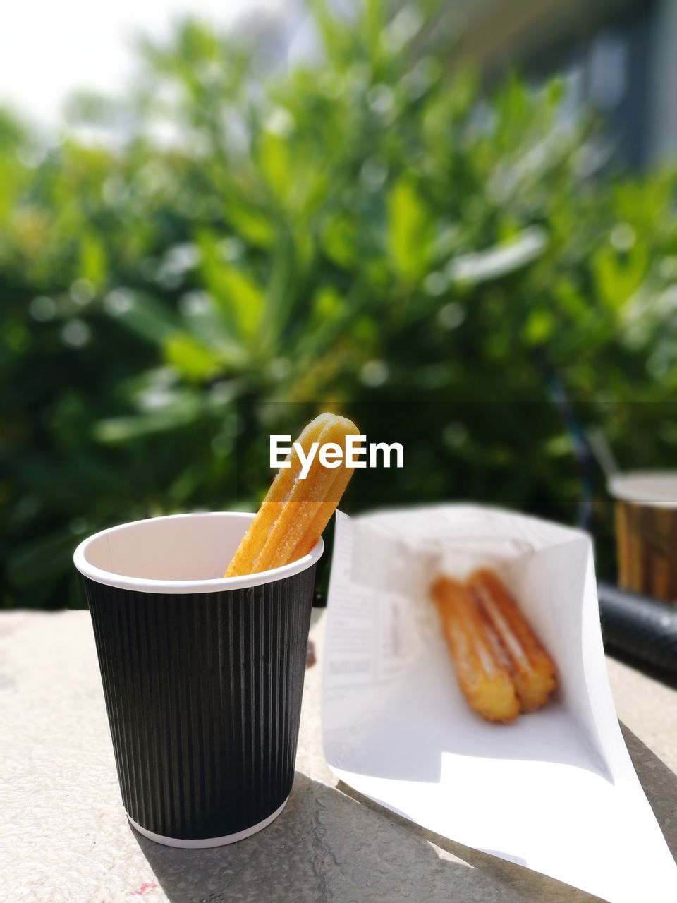 Close-up of churros in cup served on table