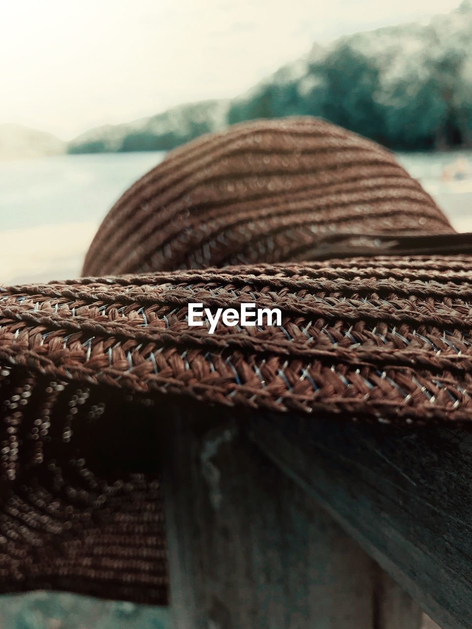 close-up, no people, pattern, brown, focus on foreground, textured, still life, wood - material, day, table, rope, hat, selective focus, wicker, outdoors, clothing, nature, textile, detail, personal accessory
