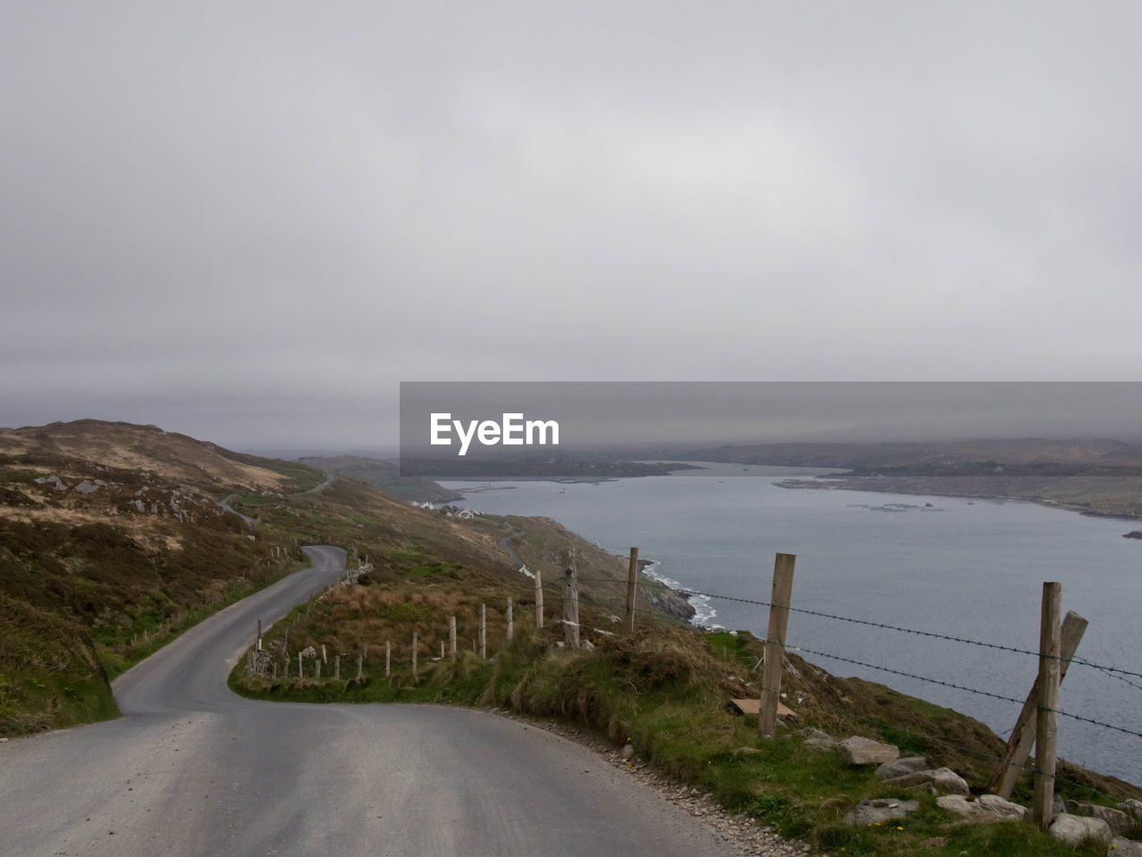 sky, water, road, scenics - nature, transportation, beauty in nature, nature, sea, tranquil scene, no people, day, cloud - sky, the way forward, tranquility, direction, non-urban scene, mountain, outdoors, horizon over water