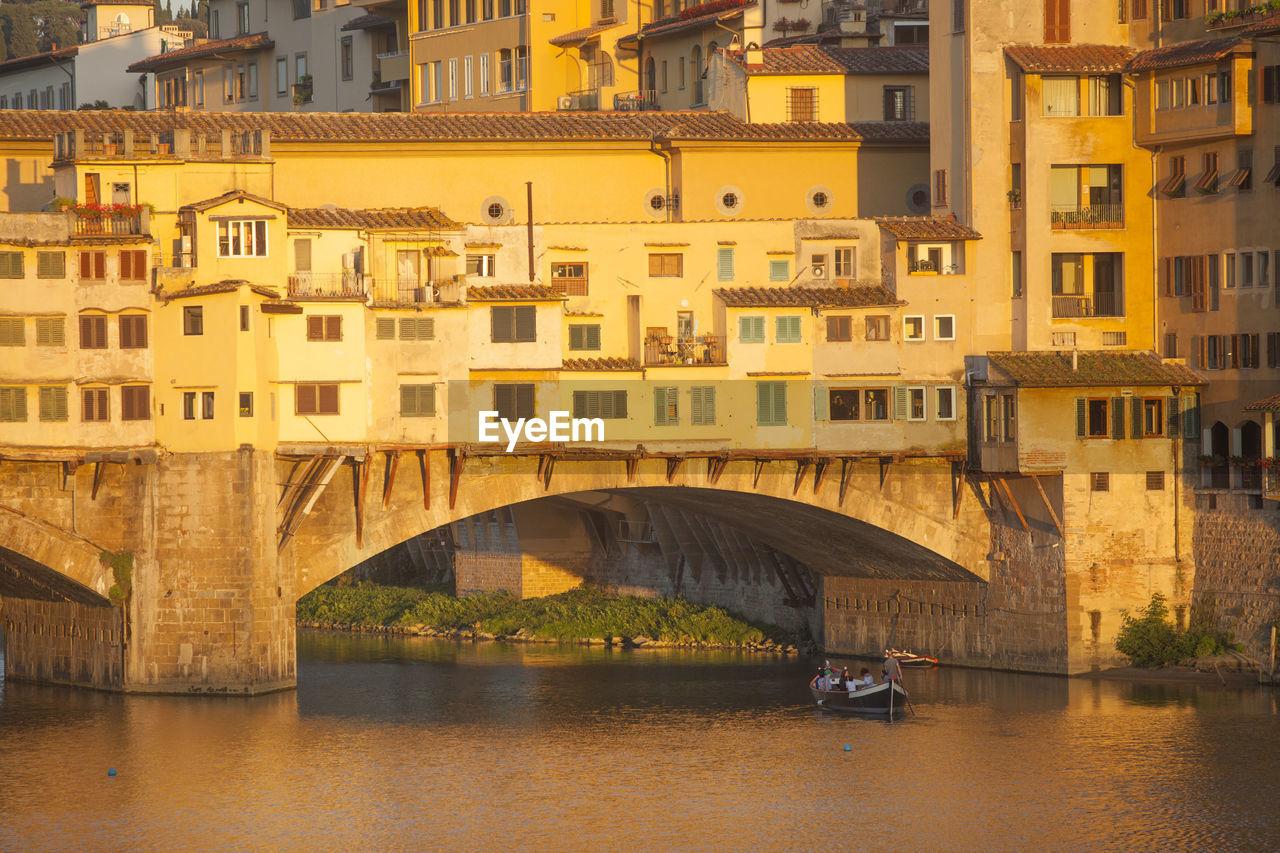 Ponte Vecchio Over River On Sunny Day