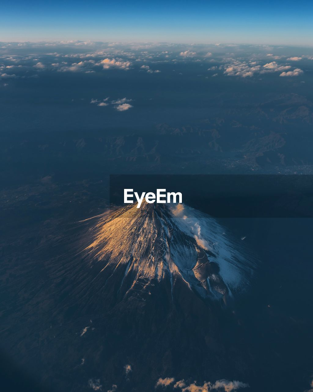 High angle view of snowcapped mountain against sky during sunset