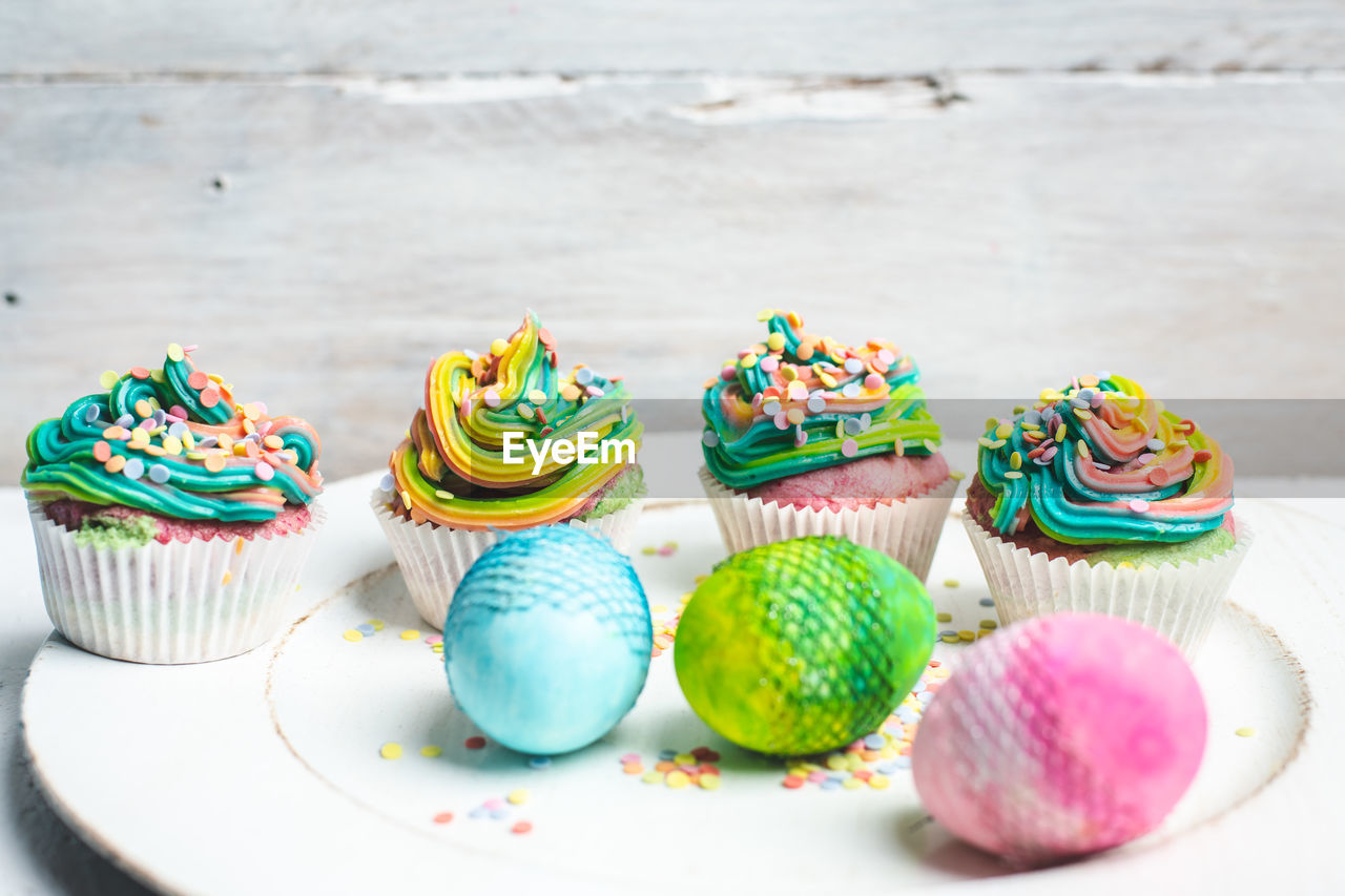 sweet food, indulgence, sweet, multi colored, cupcake, food and drink, food, temptation, dessert, still life, cake, unhealthy eating, ready-to-eat, table, no people, indoors, freshness, baked, selective focus, variation, cupcake holder, macaroon
