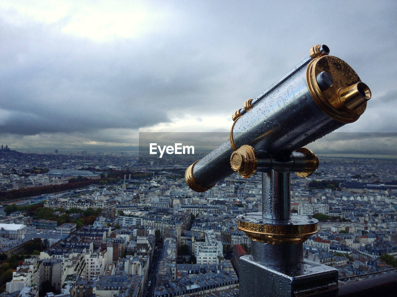 building exterior, cityscape, sky, binoculars, coin operated, architecture, city, cloud - sky, built structure, crowded, coin-operated binoculars, crowd, building, residential district, hand-held telescope, nature, metal, optical instrument, surveillance, astronomy, outdoors