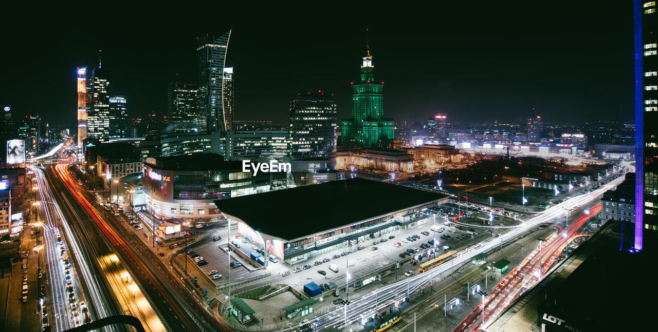 HIGH ANGLE VIEW OF ILLUMINATED CITY