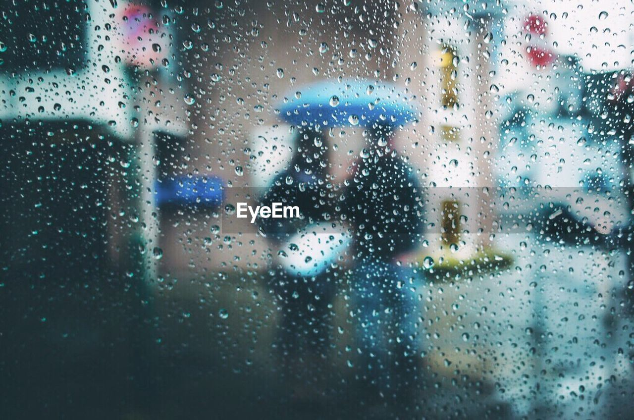 rain, window, glass - material, wet, transparent, drop, raindrop, rainy season, weather, water, looking through window, glass, indoors, full frame, condensation, one person, focus on foreground, day, backgrounds, waiting, land vehicle, frosted glass, built structure, sky, real people, close-up, lifestyles, city, only women, people