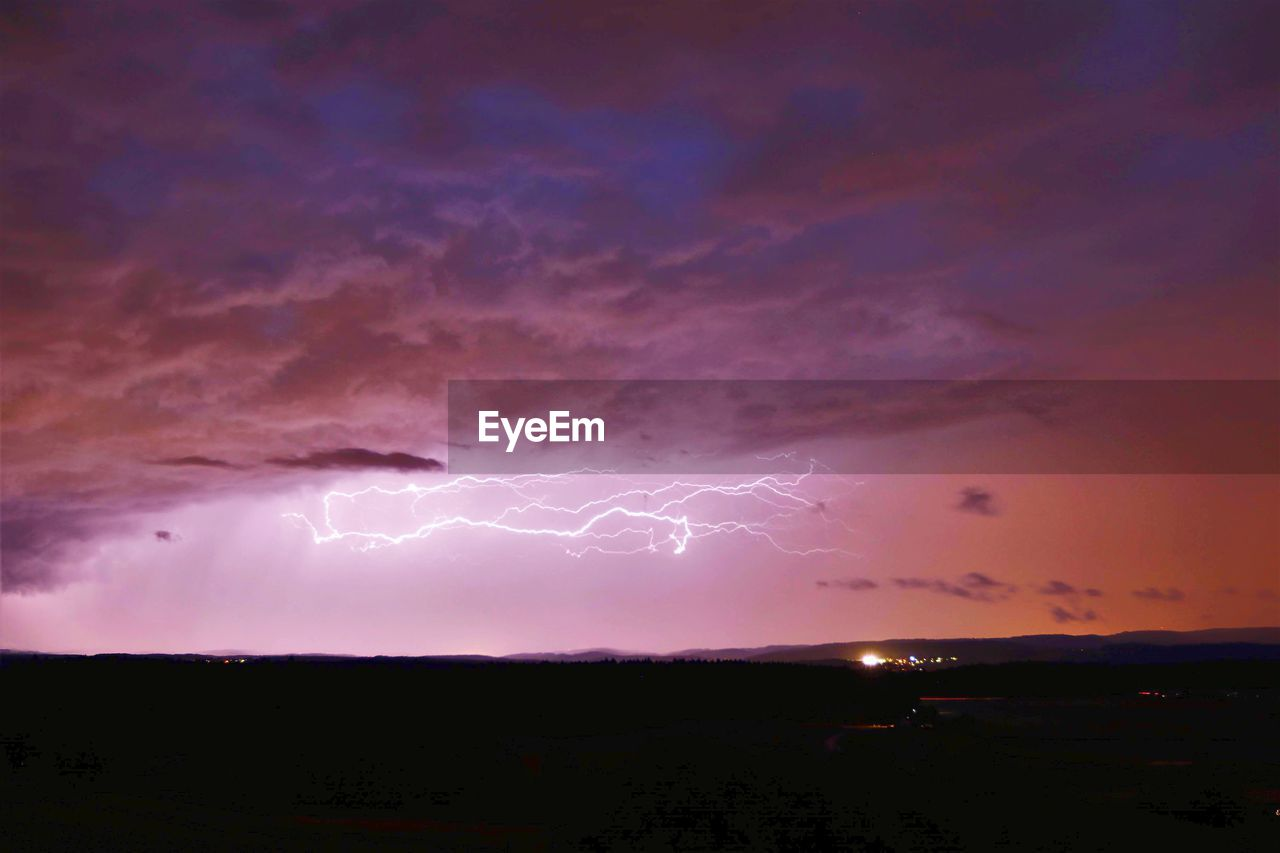 lightning, cloud - sky, sky, storm, power in nature, beauty in nature, thunderstorm, power, forked lightning, night, dramatic sky, nature, no people, storm cloud, scenics - nature, sunset, environment, warning sign, outdoors, light, purple