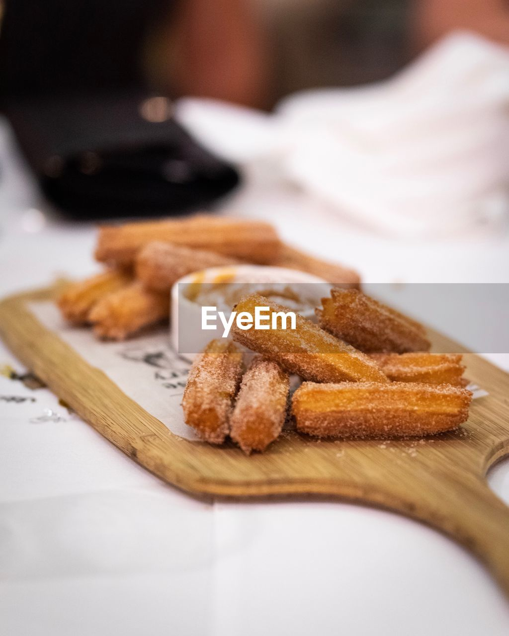 food and drink, indoors, food, ready-to-eat, table, selective focus, freshness, still life, close-up, sweet food, plate, indulgence, baked, dessert, sweet, focus on foreground, serving size, unhealthy eating, no people, temptation, snack, tray