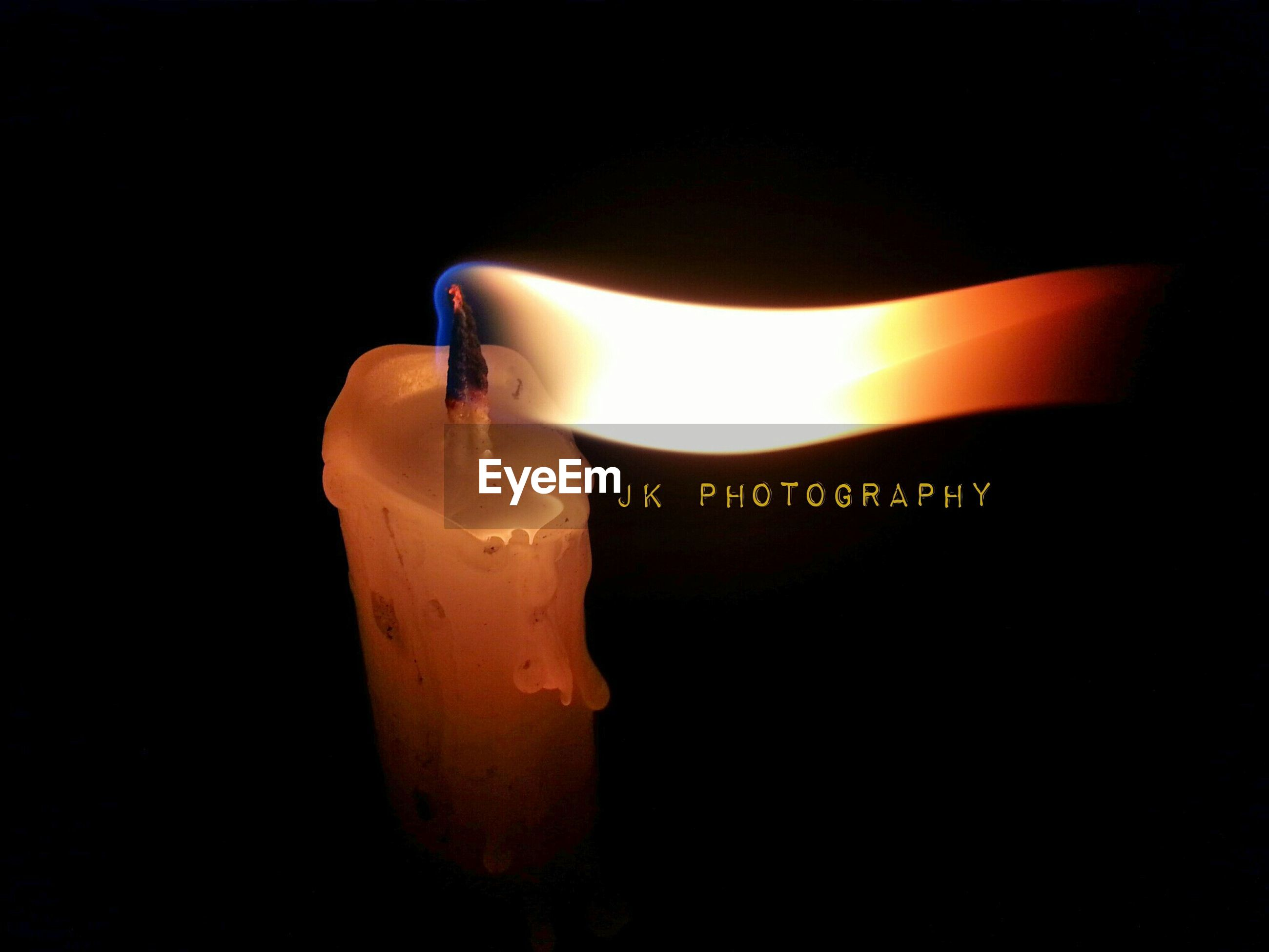 indoors, black background, studio shot, close-up, dark, still life, single object, copy space, part of, candle, darkroom, illuminated, lit, person, one person, burning, light - natural phenomenon, table, fashion