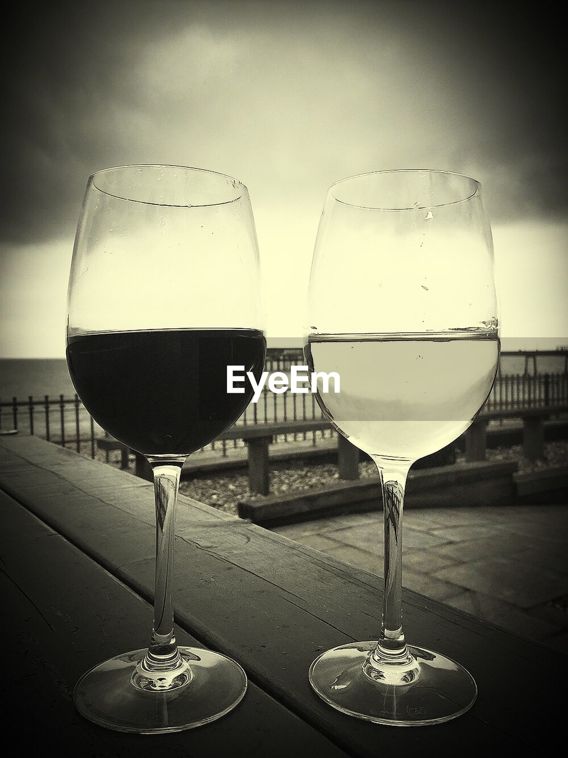 indoors, transparent, glass - material, sphere, wineglass, close-up, wine, food and drink, sky, drinking glass, mid-air, focus on foreground, drink, reflection, alcohol, still life, glass, refreshment, flying, lighting equipment