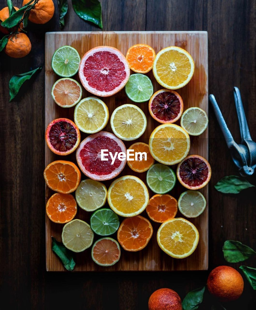 Directly Above Shot Of Various Citrus Fruits On Cutting Board