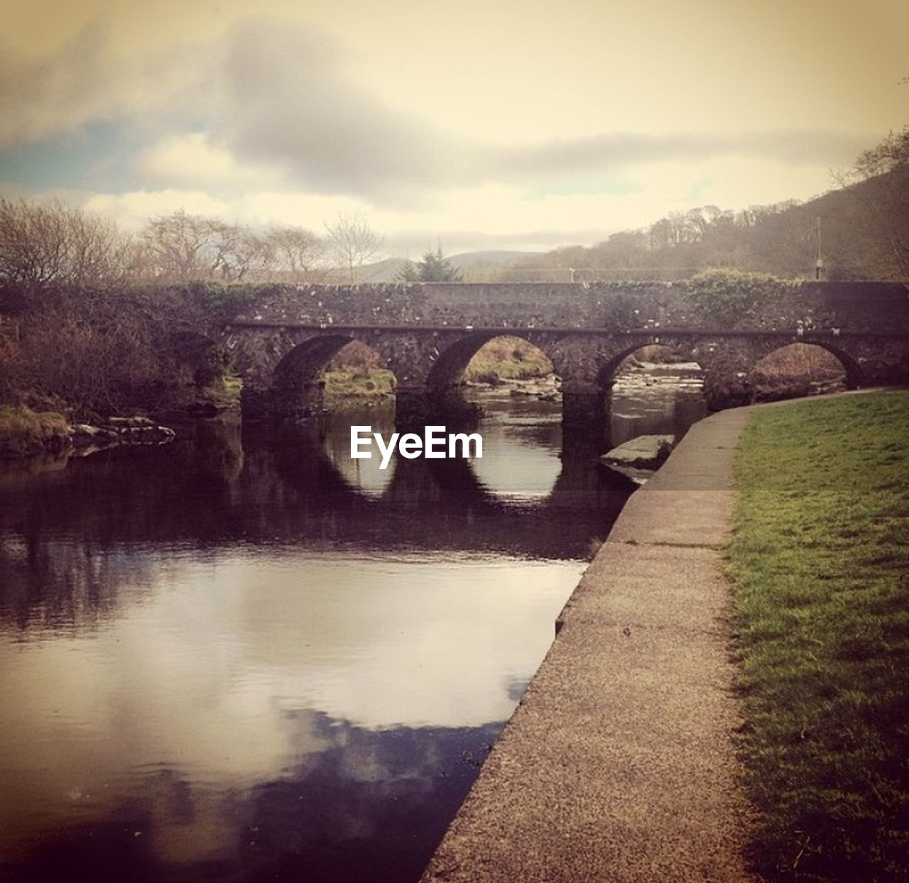 bridge - man made structure, connection, river, water, architecture, sky, no people, arch, built structure, bridge, outdoors, nature, tree, day, tranquility, landscape, scenics, beauty in nature