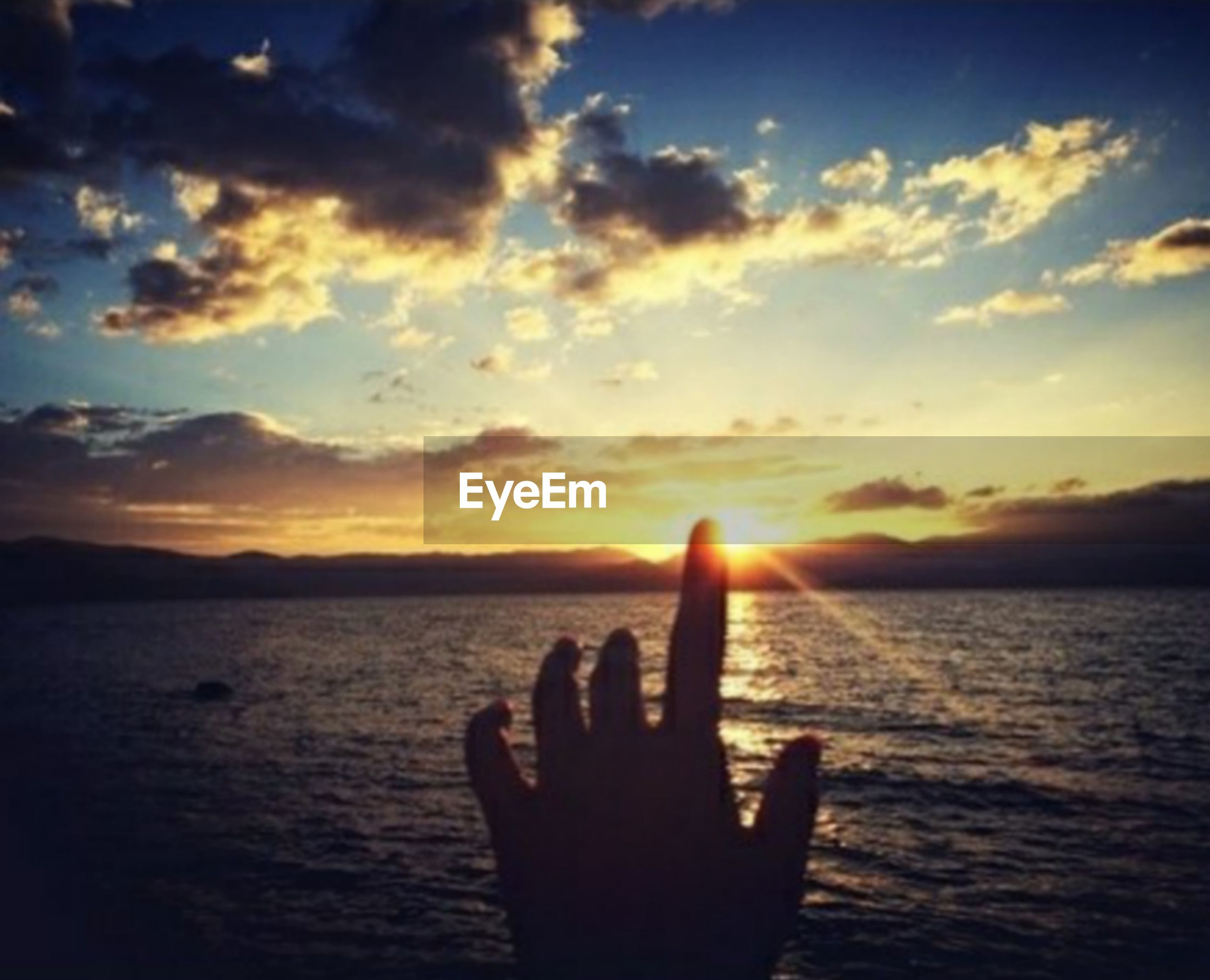 human hand, sunset, sea, human body part, human finger, sky, cloud - sky, horizon over water, one person, silhouette, water, sunlight, nature, outdoors, beach, beauty in nature, scenics, people, close-up, day, adult, adults only