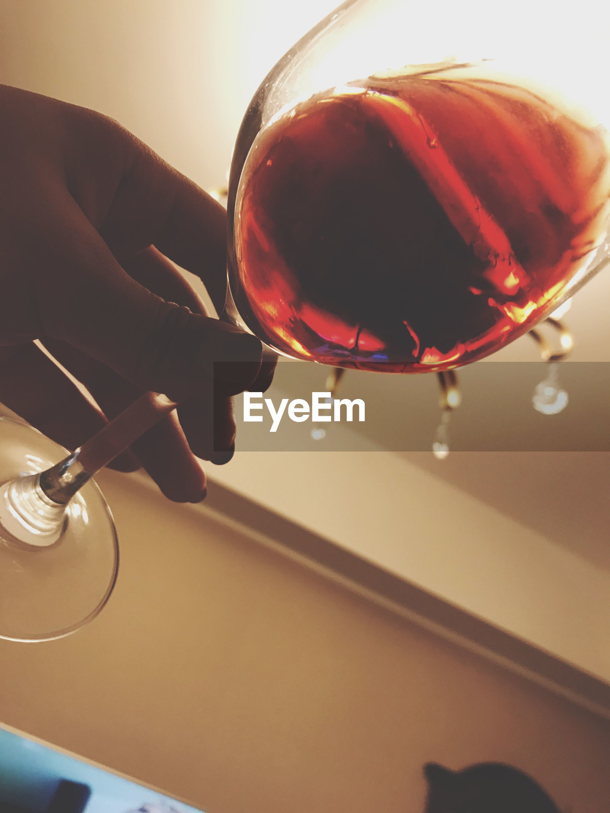 refreshment, human hand, indoors, one person, real people, pouring, food and drink, freshness, close-up, holding, wineglass, human body part, water, food, dripping, day, people