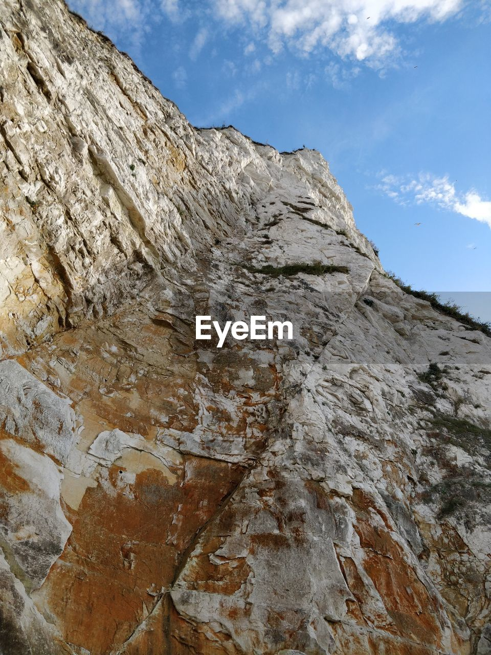 sky, rock, cloud - sky, rock formation, mountain, rock - object, low angle view, nature, day, solid, no people, beauty in nature, tranquility, geology, non-urban scene, outdoors, textured, scenics - nature, land, strength, formation, eroded, mountain peak