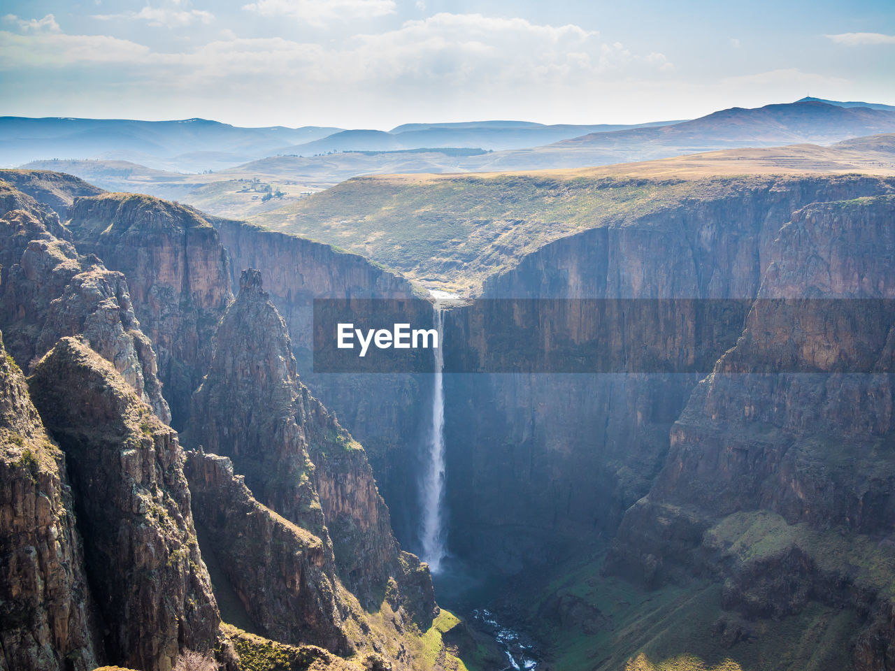 Panoramic view of maletsunyane waterfall against dramatic sky, semonkong, lesotho, africa