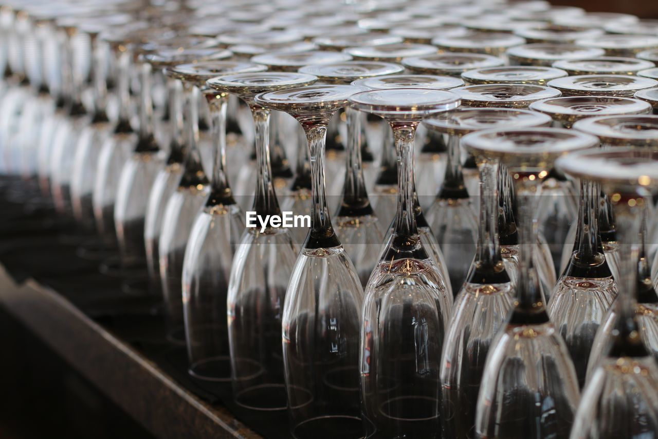 Close-up of upside down champagne flutes arranged on table