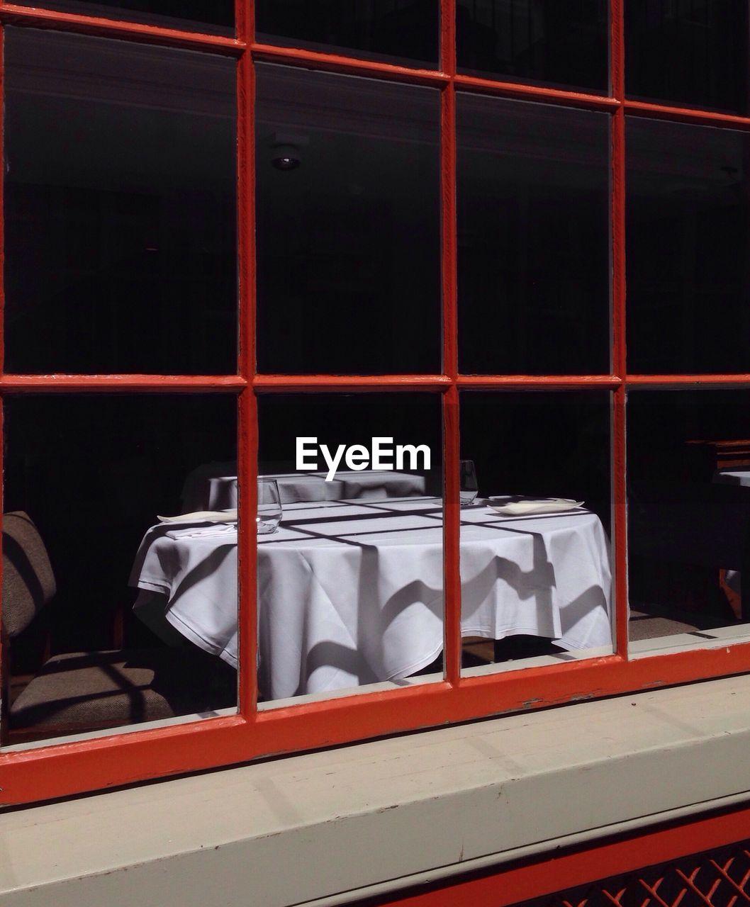Table In Restaurant Seen Through Window