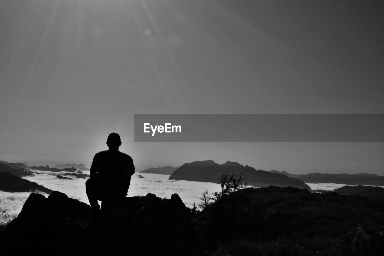 Silhouette Man Overlooking Calm Sea