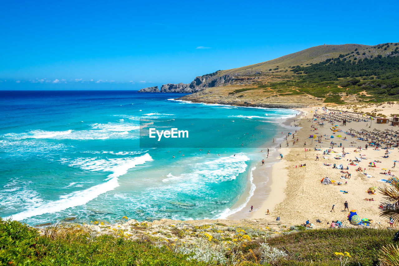 water, sea, land, beach, beauty in nature, scenics - nature, blue, sky, tranquil scene, nature, day, tranquility, wave, sand, mountain, idyllic, motion, non-urban scene, outdoors, turquoise colored