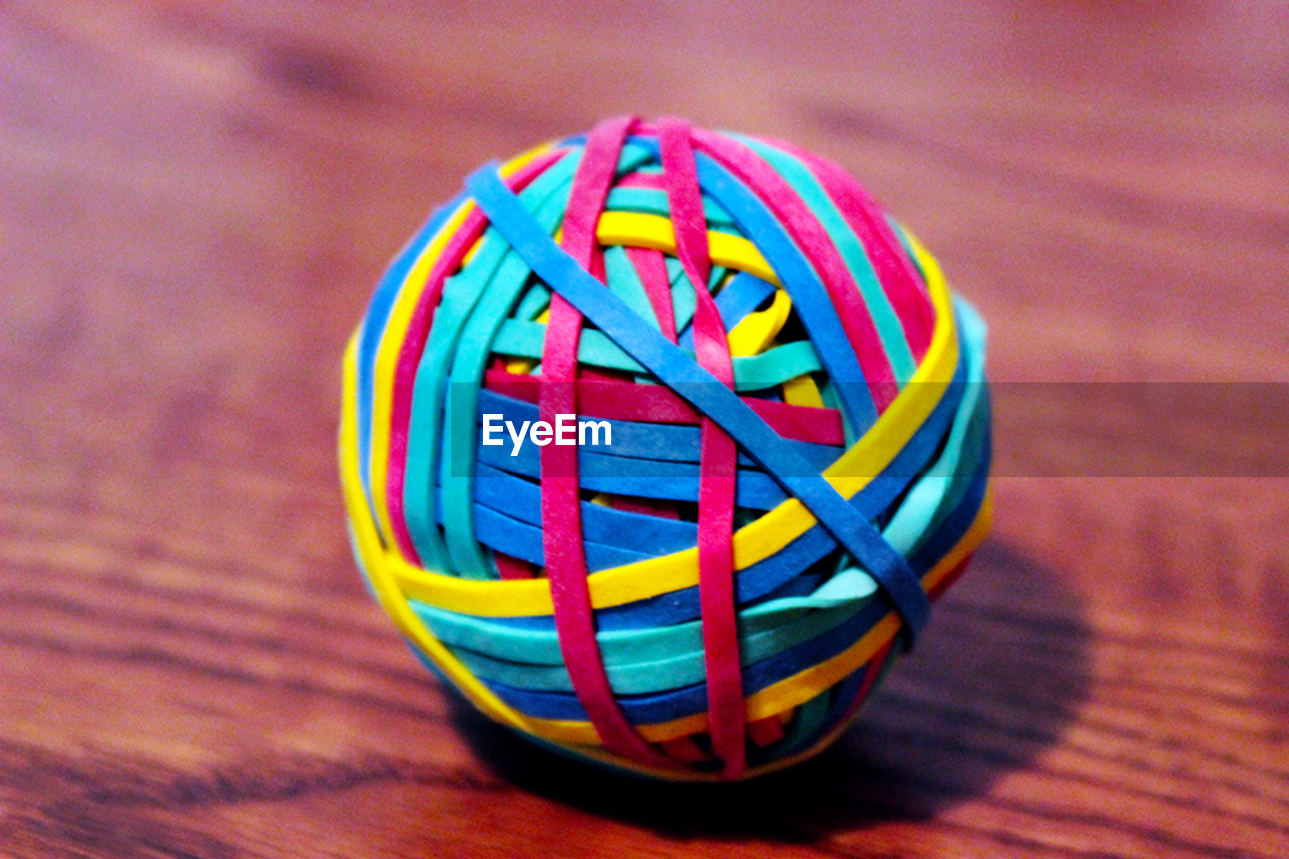 circle, close-up, multi colored, indoors, focus on foreground, pattern, single object, still life, selective focus, geometric shape, no people, table, colorful, wood - material, design, yellow, day, shape, creativity