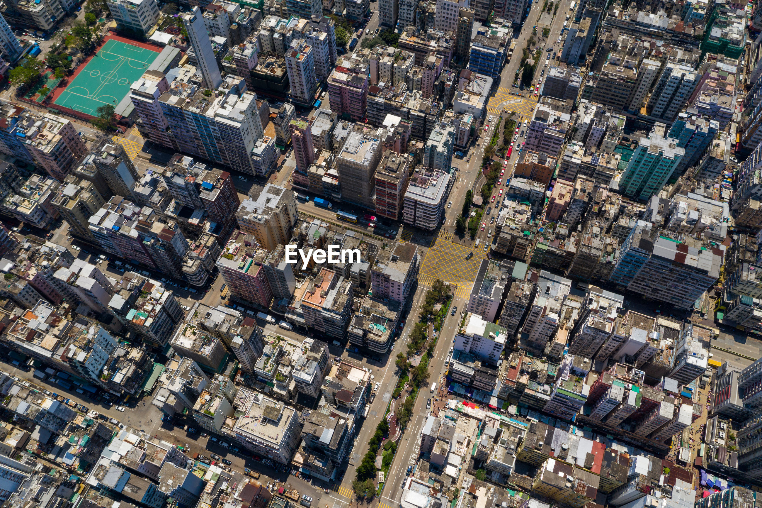 Aerial view of street amidst buildings in town