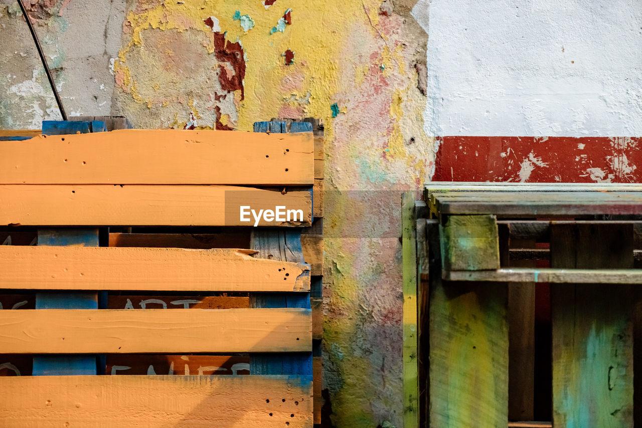 CLOSE-UP OF GRAFFITI ON OLD WALL