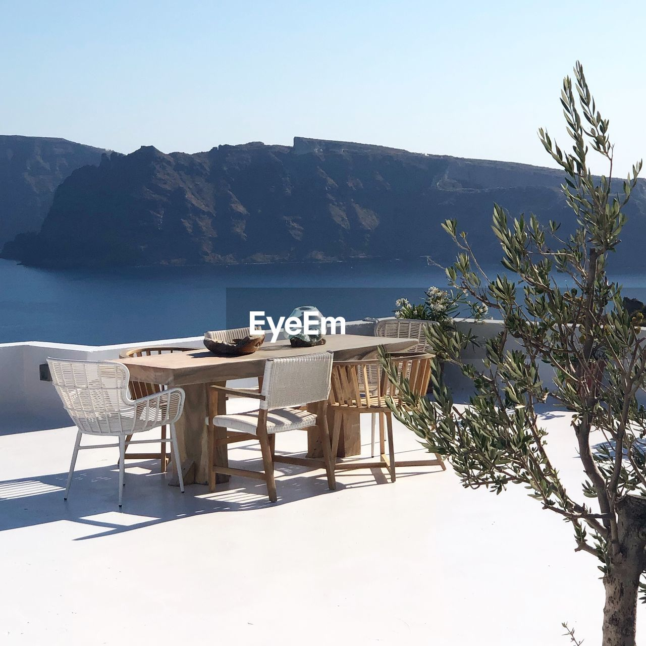 mountain, beauty in nature, nature, sky, chair, scenics - nature, table, sea, water, seat, plant, tranquil scene, tranquility, day, clear sky, no people, sunlight, idyllic, outdoors