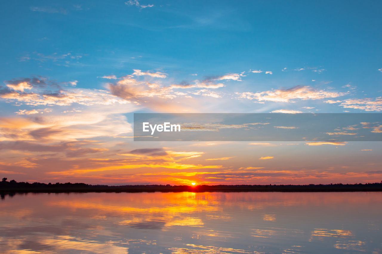 sky, sunset, cloud - sky, beauty in nature, scenics - nature, tranquility, tranquil scene, water, reflection, idyllic, orange color, waterfront, nature, lake, no people, non-urban scene, outdoors, dramatic sky, romantic sky