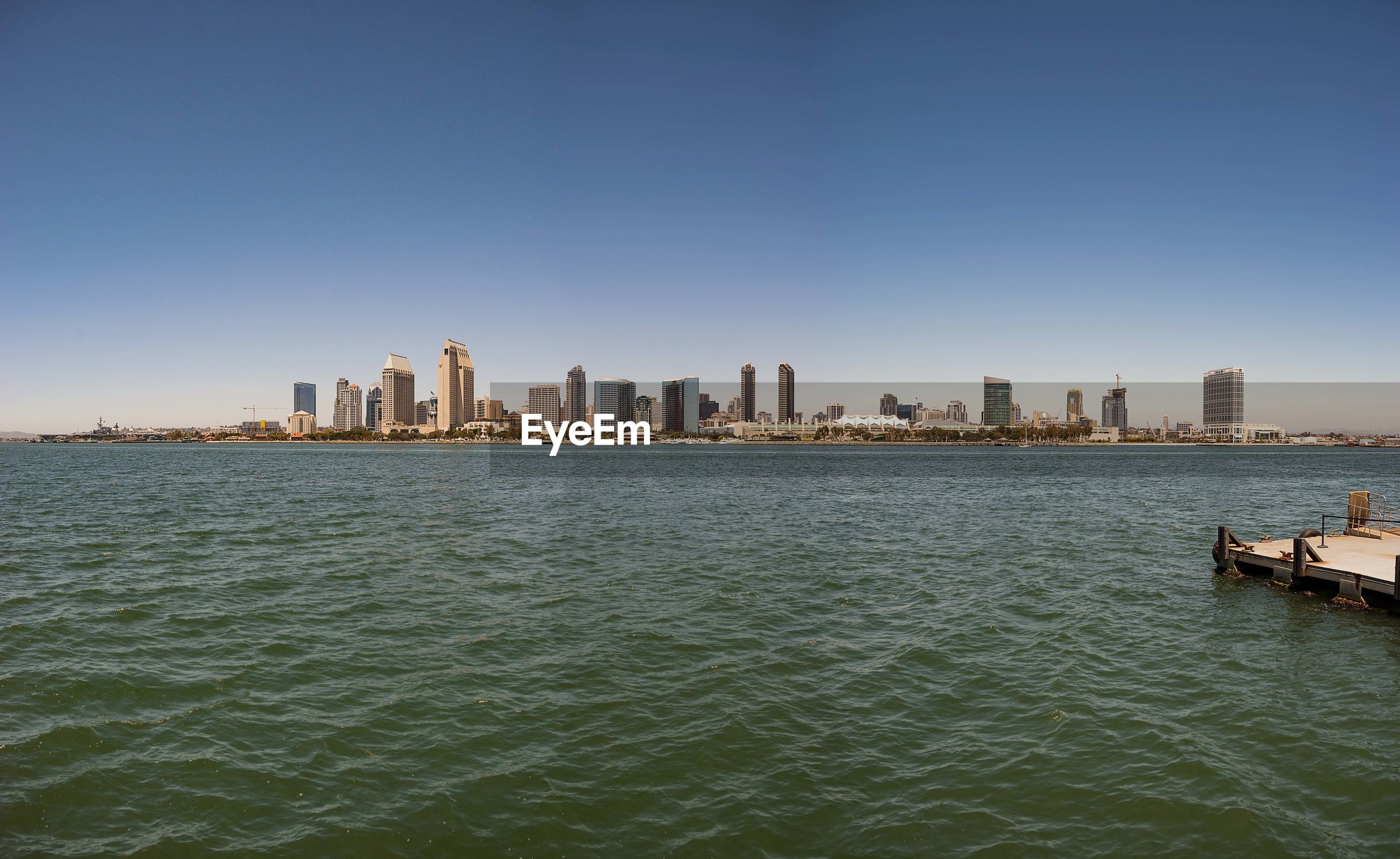 SEA WITH CITY IN BACKGROUND