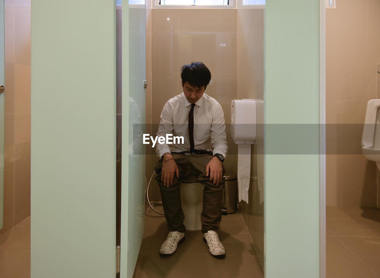 Full Length Of Man In Toilet