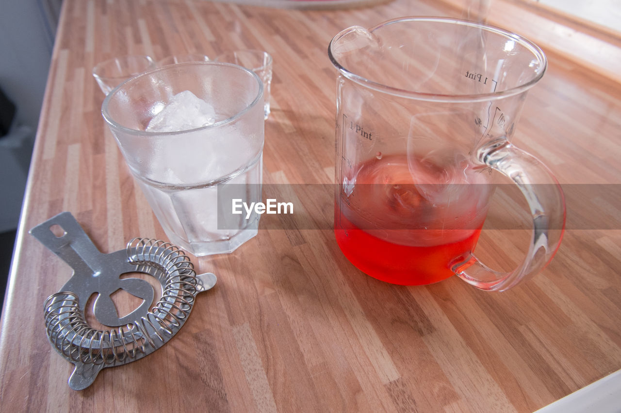 table, drink, food and drink, refreshment, transparent, indoors, glass, still life, wood - material, household equipment, glass - material, high angle view, no people, close-up, freshness, drinking glass, food, cup, tea, crockery
