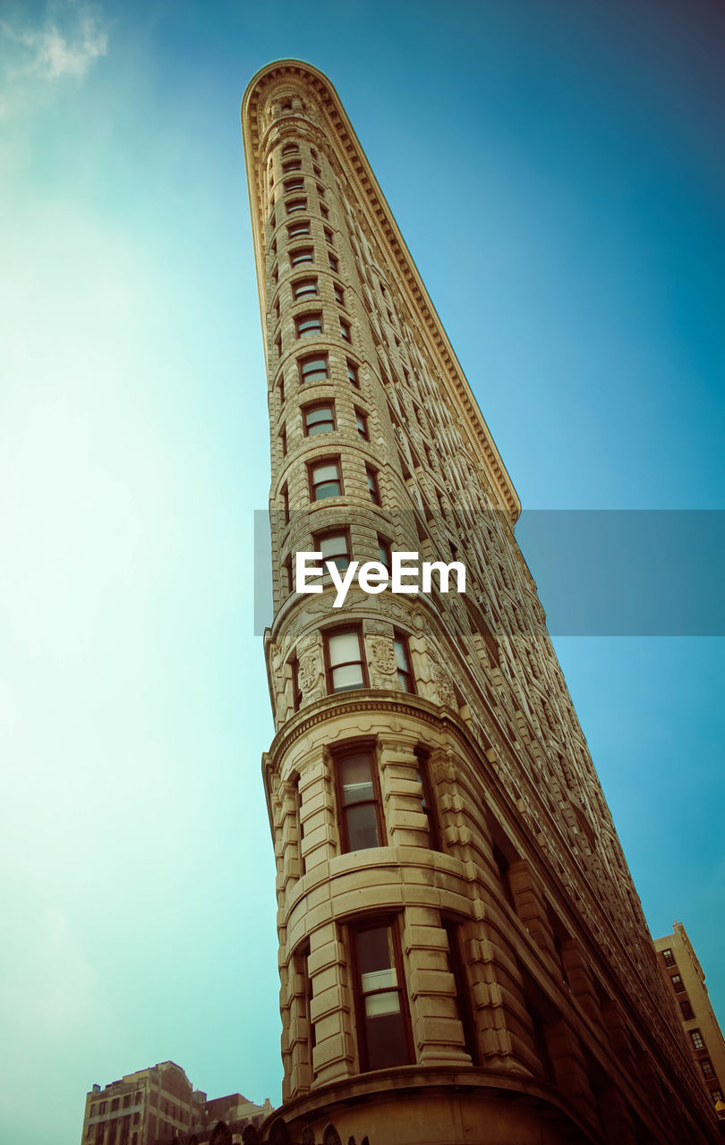 low angle view, architecture, history, built structure, tower, travel destinations, building exterior, day, outdoors, ancient, no people, tall, skyscraper, sky, ancient civilization