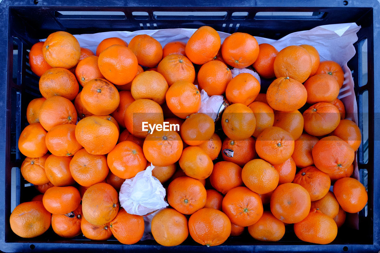 orange color, fruit, freshness, healthy eating, food and drink, retail, food, market, for sale, abundance, large group of objects, consumerism, outdoors, no people, day, business, close-up