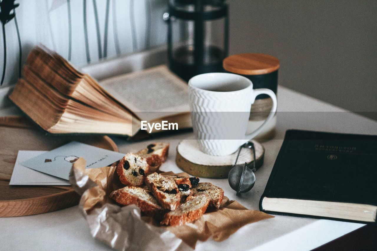 Close-up of coffee cup and bread on table