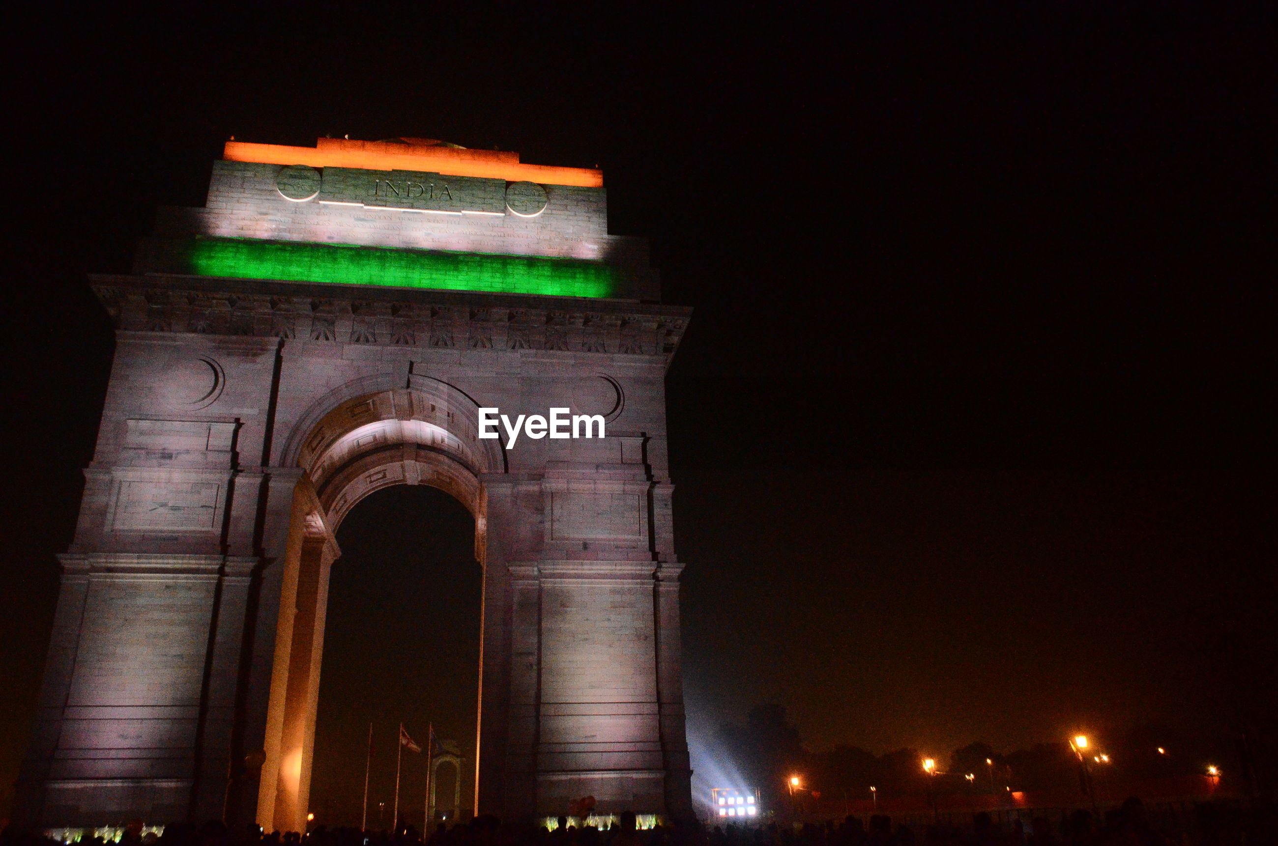 Low angle view of illuminated india gate against sky at night