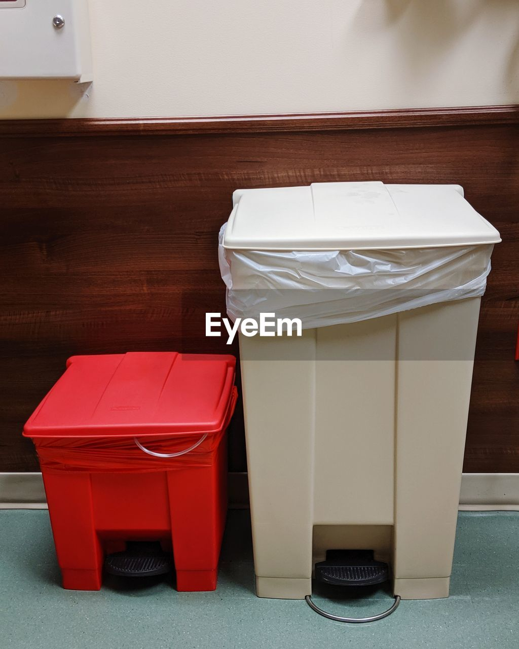 Garbage cans against wall at home