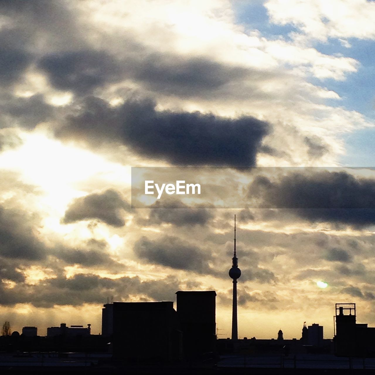 architecture, building exterior, built structure, communication, tall - high, tower, city, television tower, sky, sunset, cloud - sky, modern, outdoors, no people, travel destinations, skyscraper, cityscape, day