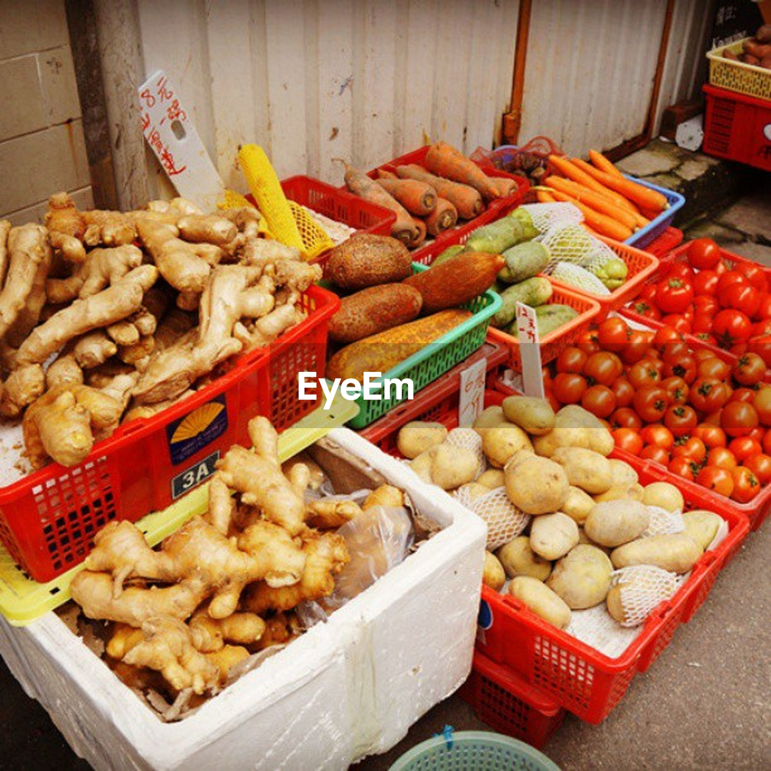 food and drink, food, freshness, healthy eating, large group of objects, for sale, abundance, retail, indoors, variation, market, market stall, choice, still life, vegetable, price tag, high angle view, sale, arrangement, display