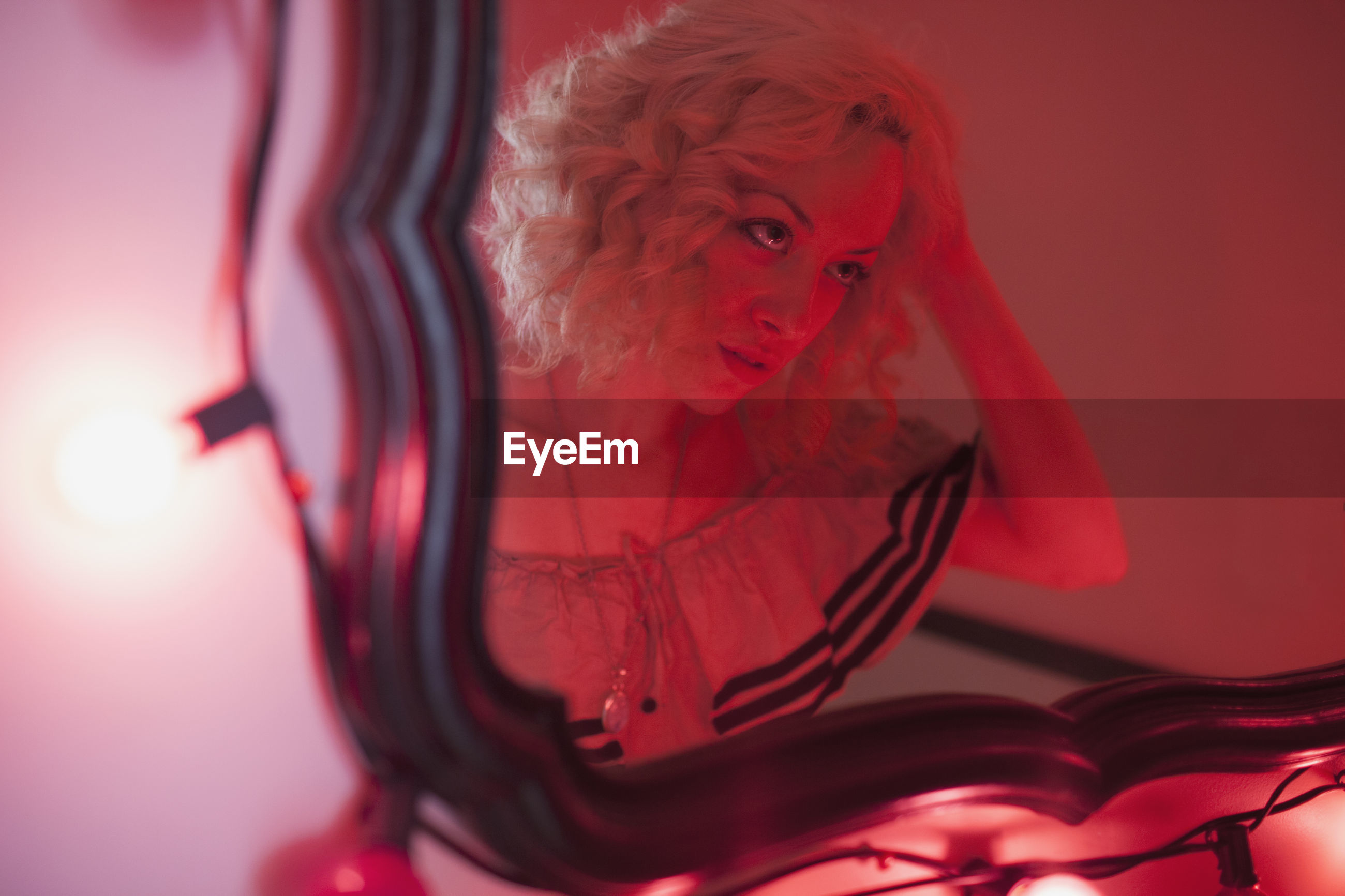 CLOSE-UP PORTRAIT OF WOMAN WITH RED LIGHT PAINTING