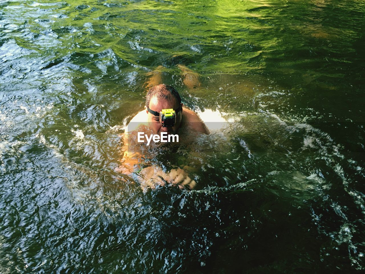 High Angle View Of Shirtless Man Swimming In Sea