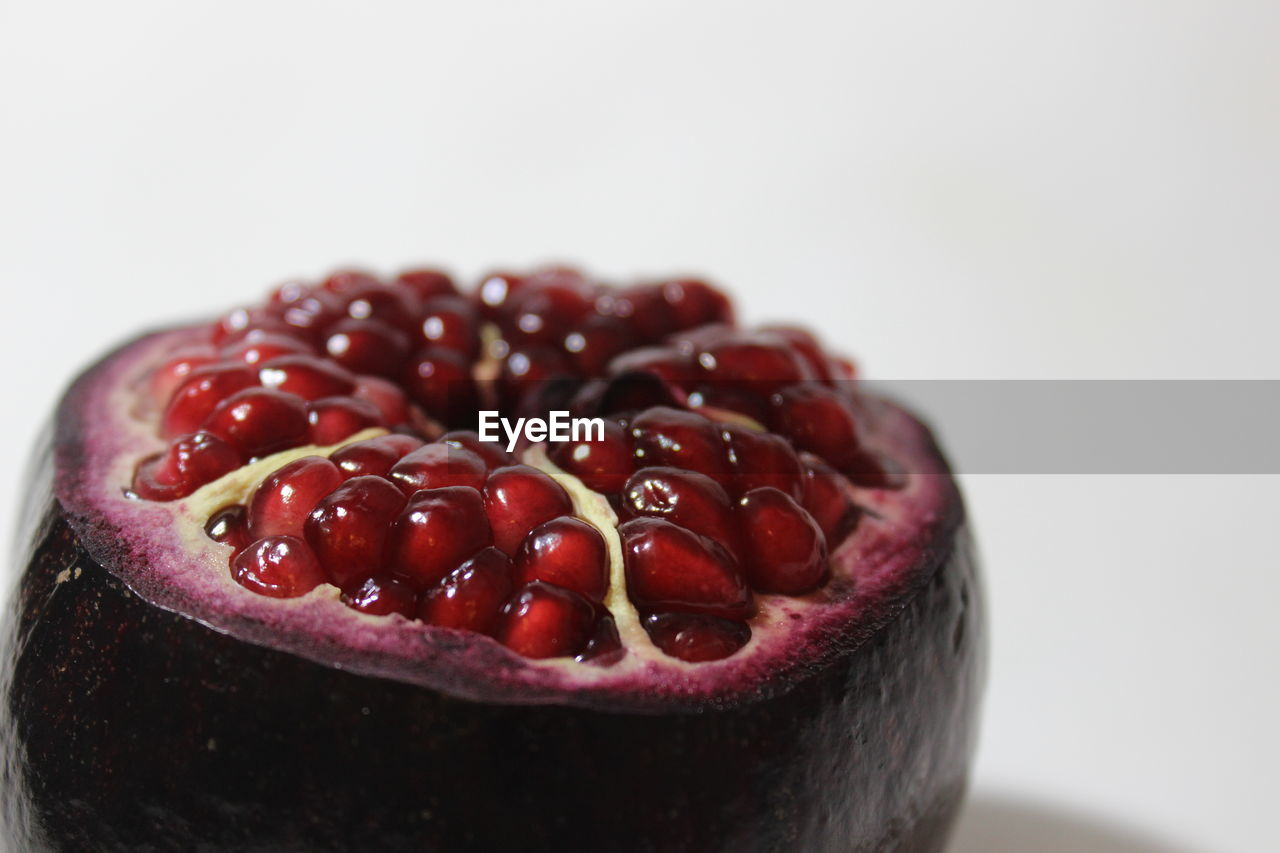 food and drink, food, freshness, close-up, healthy eating, fruit, still life, wellbeing, studio shot, white background, indoors, red, no people, copy space, pomegranate, seed, focus on foreground, berry fruit, ready-to-eat, temptation, ripe