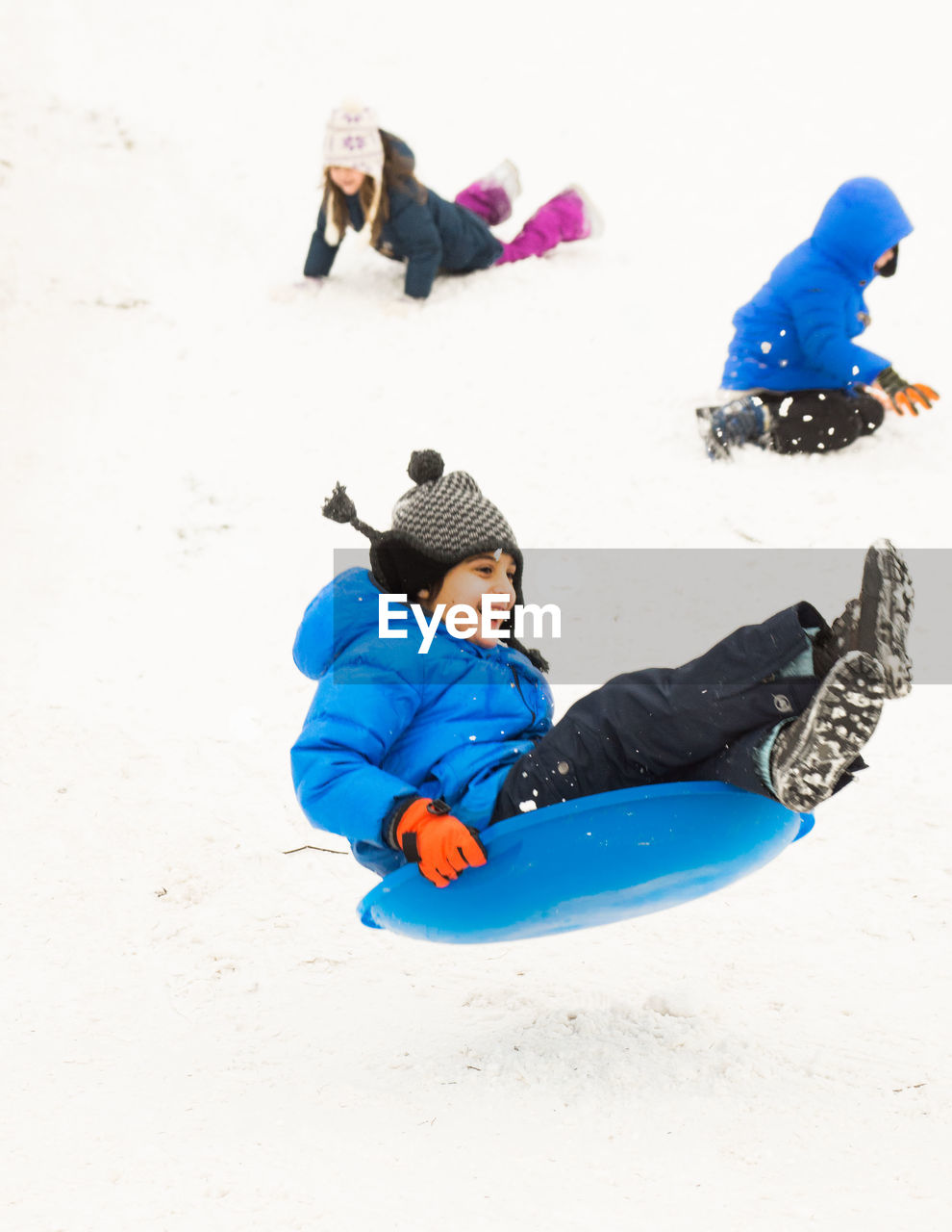 full length, childhood, playing, real people, fun, leisure activity, cold temperature, enjoyment, outdoors, day, boys, girls, happiness, one person, smiling, warm clothing, nature