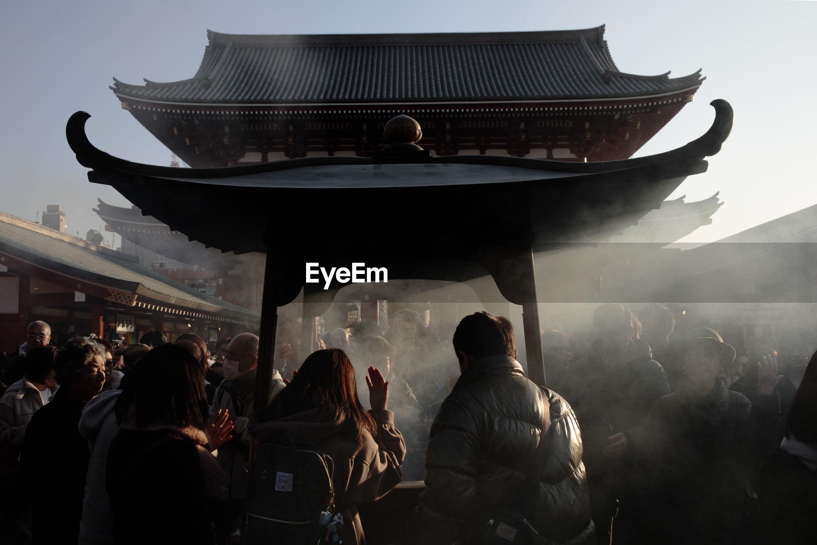 Celebrants attend seijin no hi or coming of age day, senso-ji buddhist temple, asakusa, tokyo, japan