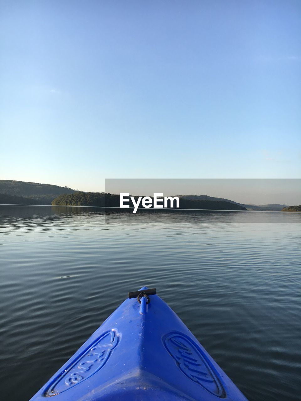 water, blue, sky, scenics - nature, tranquil scene, beauty in nature, tranquility, nature, lake, nautical vessel, day, no people, transportation, non-urban scene, kayak, copy space, mode of transportation, clear sky, outdoors, floating on water, inflatable