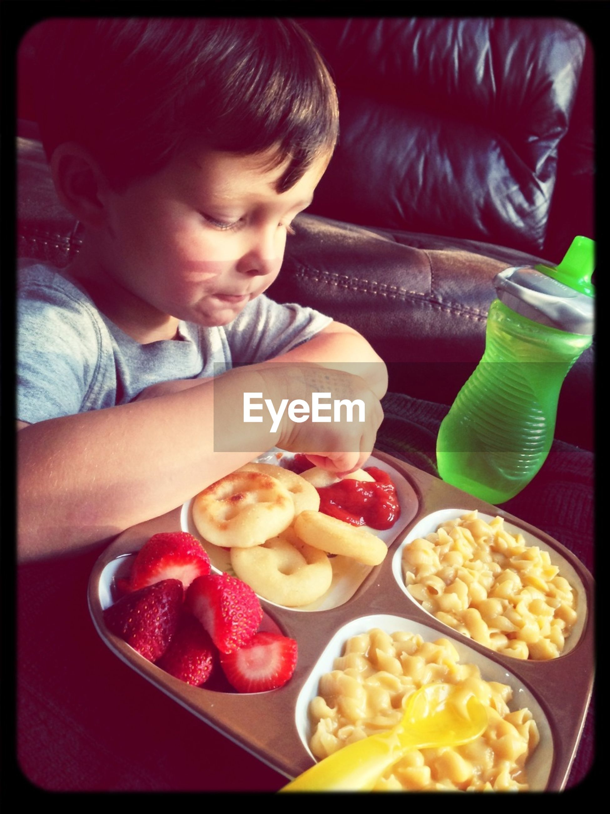food and drink, food, indoors, transfer print, freshness, lifestyles, childhood, holding, elementary age, healthy eating, person, leisure activity, auto post production filter, ready-to-eat, casual clothing, boys, plate, cute