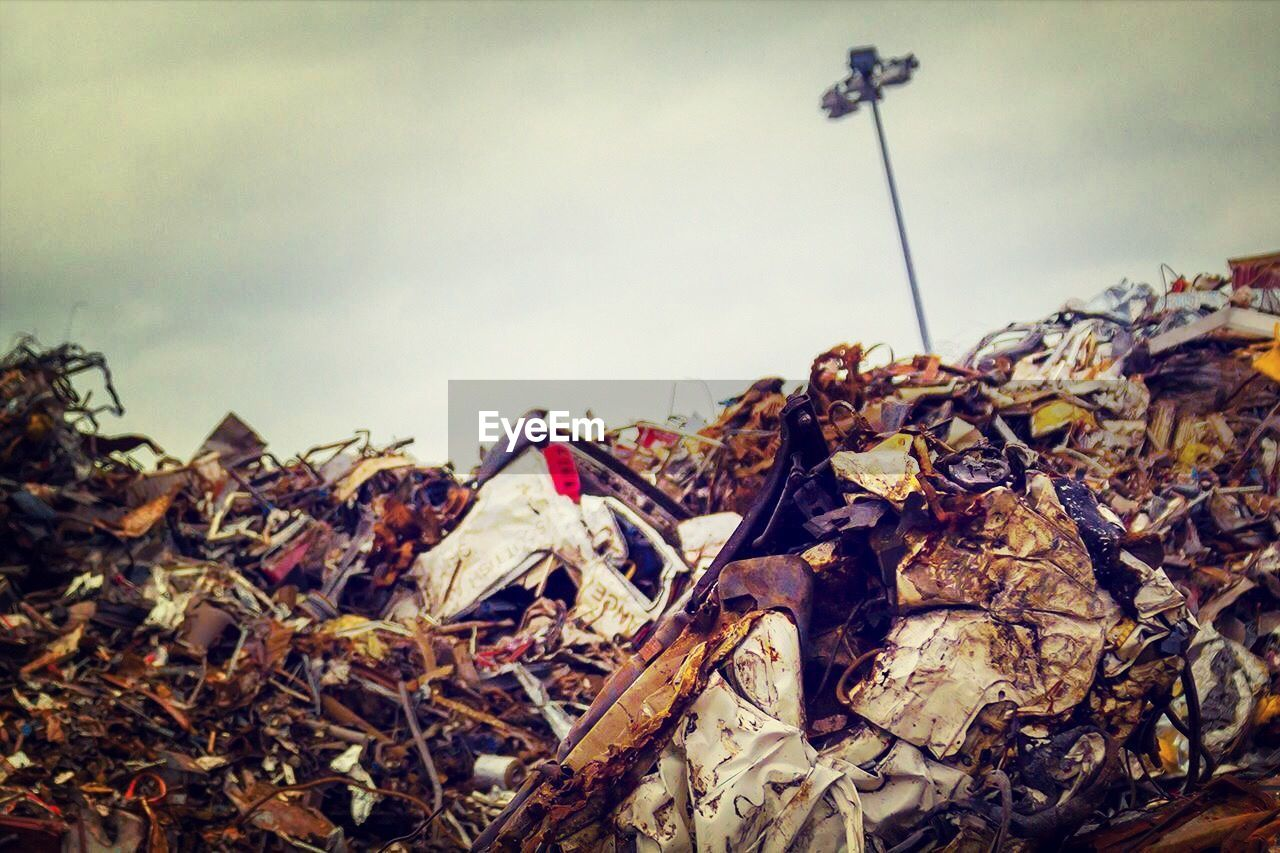 dry, leaf, autumn, no people, sky, heap, day, outdoors, nature, scrap metal, low angle view, waste management, close-up