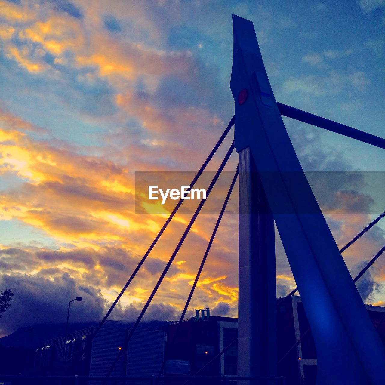 cloud - sky, sky, sunset, outdoors, built structure, transportation, bridge - man made structure, no people, architecture, low angle view, travel destinations, nature, day, city
