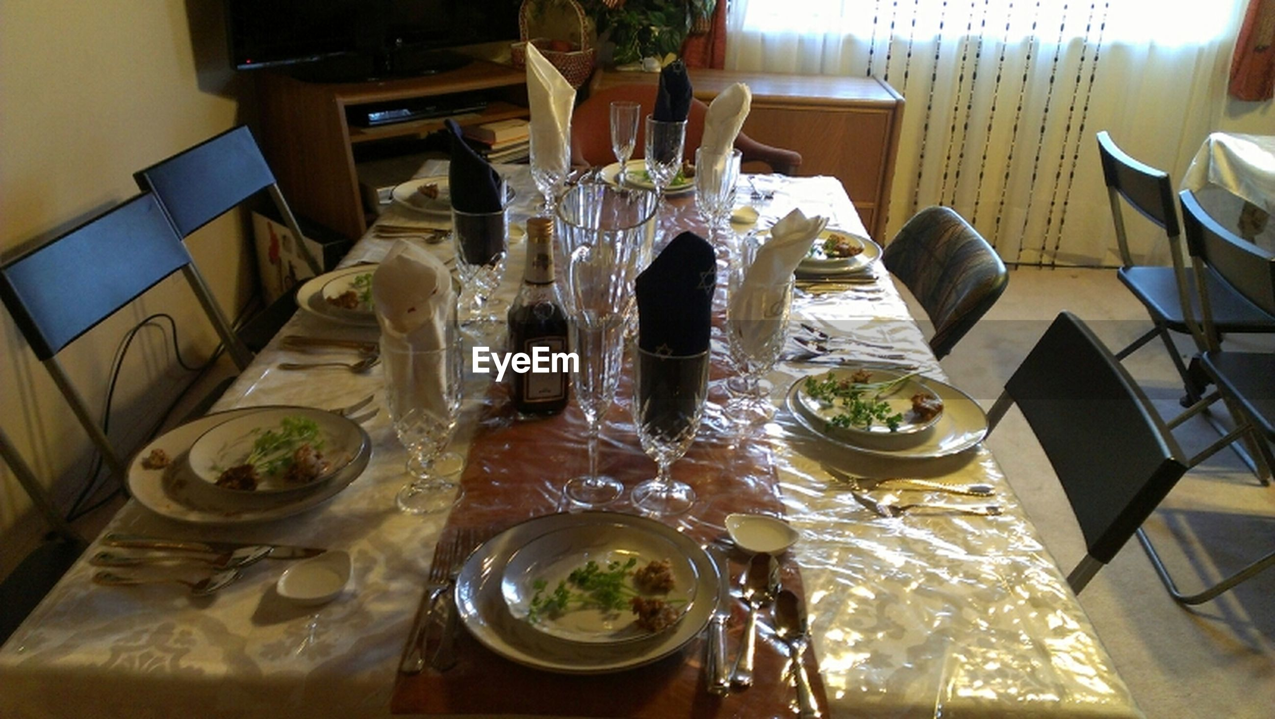 indoors, table, food and drink, still life, high angle view, arrangement, drink, drinking glass, food, home interior, dining table, plate, freshness, restaurant, no people, place setting, glass - material, absence, variation, chair