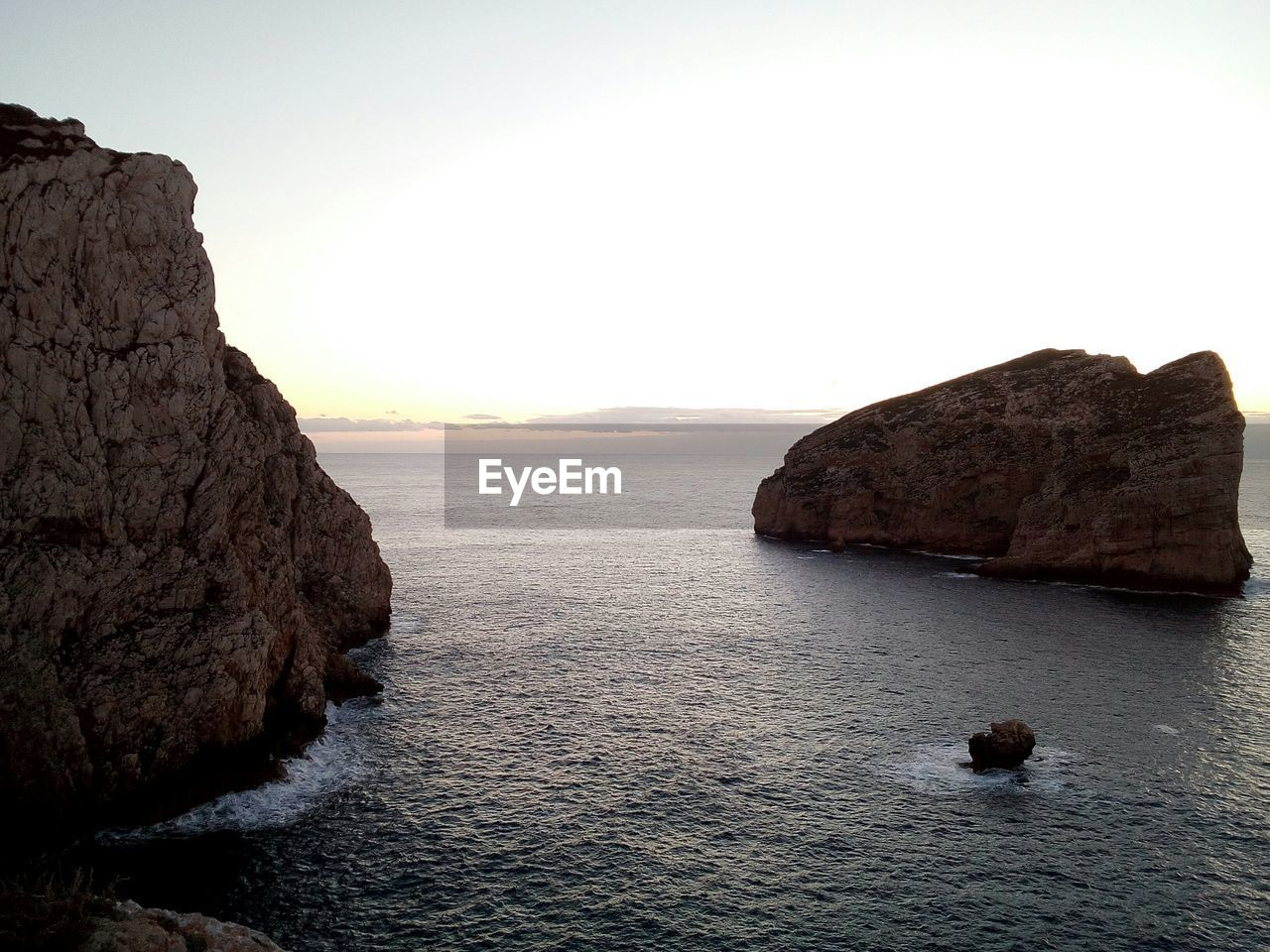 sea, water, sky, beauty in nature, scenics - nature, rock, tranquil scene, rock formation, rock - object, tranquility, waterfront, solid, nature, sunset, no people, non-urban scene, idyllic, horizon, horizon over water, outdoors, stack rock, eroded