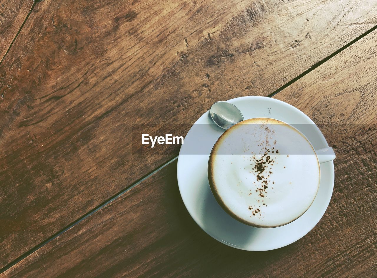 refreshment, drink, cup, mug, table, coffee cup, food and drink, coffee, coffee - drink, wood - material, still life, high angle view, frothy drink, directly above, freshness, saucer, crockery, indoors, no people, hot drink, non-alcoholic beverage, latte, froth